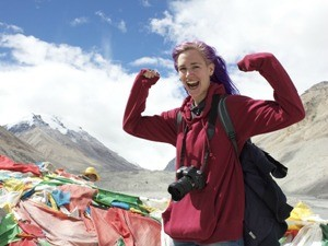 woman smiling with flags in Nepal