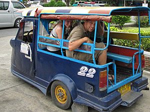 Customers in a blue tuk tuk in Thailand