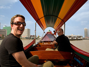 Man smiling on a boat in Bangkok Thailand
