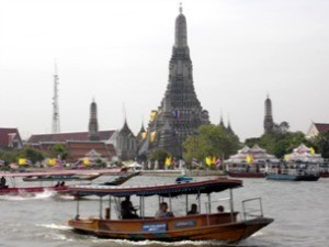 Boats on the river and Bangkok city in the background
