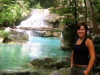 Woman standing next to a waterfall