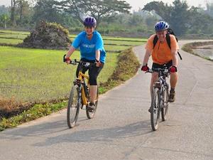 two people cycling