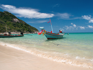 Boats at the beach at ko phagnan thailand