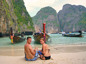 Couple sitting on the beach in thailand