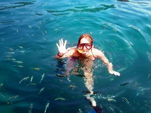 Woman snorkeling with fishes