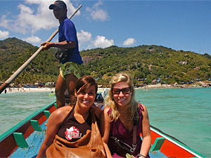 women on longtail boat in thailand
