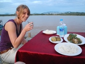 Woman eating and drinking on a boat