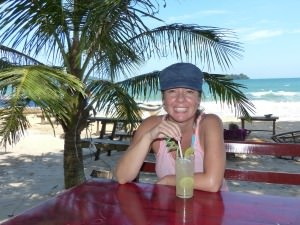 emma drinking on the cambodia beach