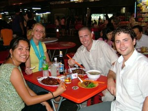 people eating at market in malaysia