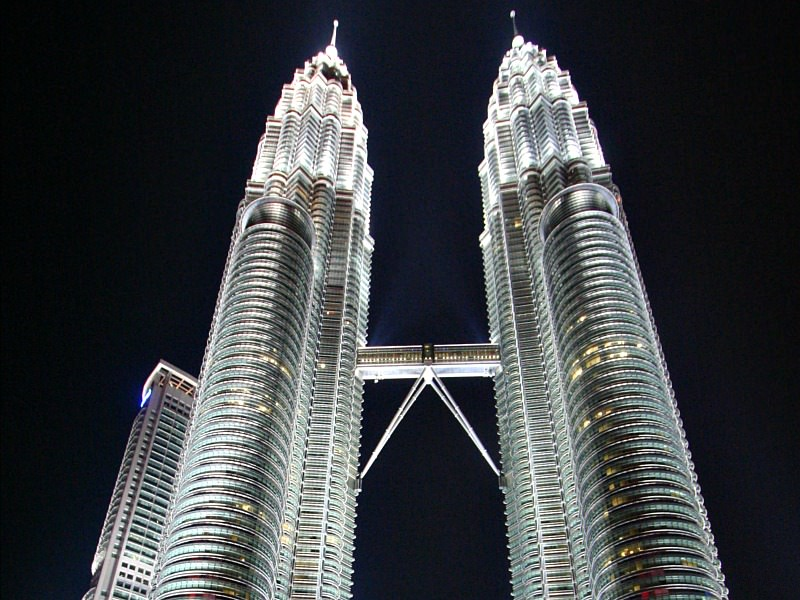 Brightly lit twin towers in Malaysia at night