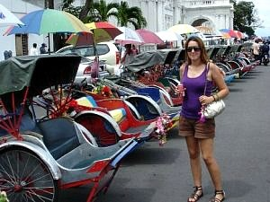 woman standing in front of trishaws