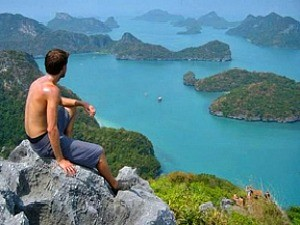 man looking over islands in ocean in malaysia