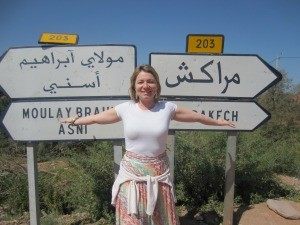 Woman standing by a sign in Morocco