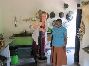 Travel Specialist Ceri cooking with local woman