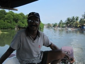 local guide in boat on river