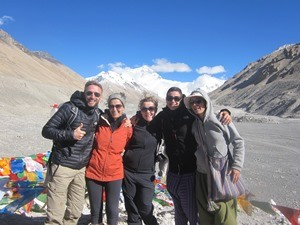 Group of travellers in front of Everest in Tibet