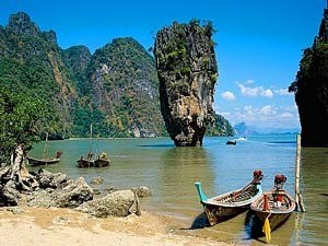 longtail boats on the beach in thailand