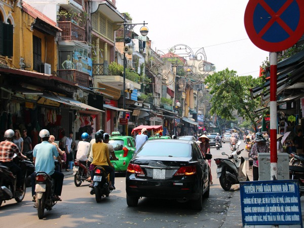 Cars and mopeds in Hanoi Vietnam