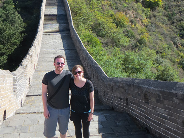 Couple standing at Great Wall of China