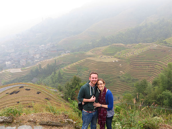 couple in the rice terraces of pingan, china