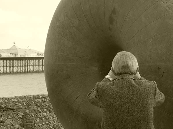 man looking out to sea in Brighton