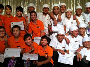 kids graduating from cooking school in vietnam