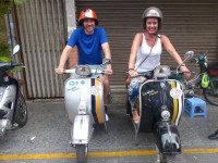 Emma and Mark on vespas in Vietnam