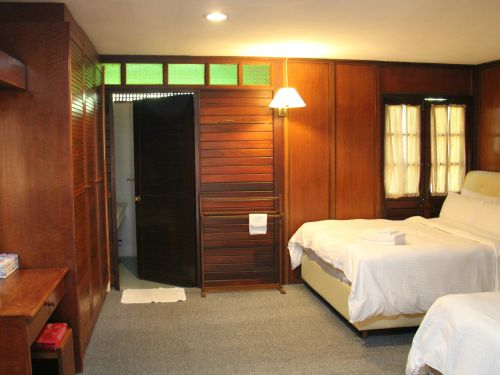 Bedroom inside wooden chalet accommodation