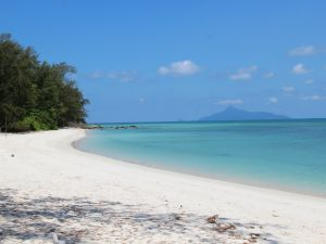 White sandy beach and blue sea at Pulau Besar