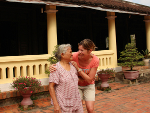local woman and tourist in Vietnam