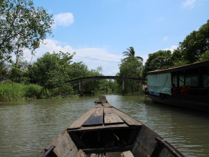 Wooden boat sailing on Mekong Delta