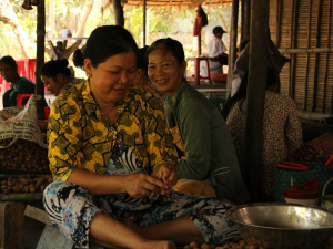 Woman cooking on the Mekong Delta