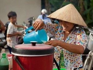Local woman on market stall in vietnam