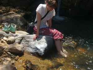 girl with feet in the river