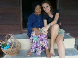 Thai lady sitting on step with tourist