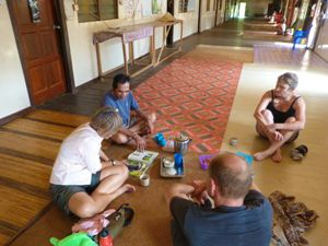travellers sitting with Iban locals on the floor