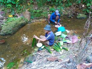 local washing in the river in borneo