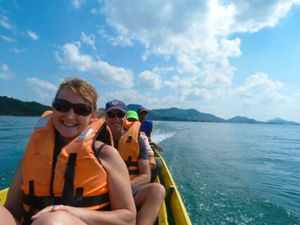 travellers on a boat to homestay