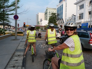 People riding bikes with high vis and helmets in penang