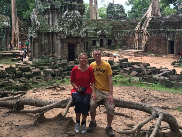 customers sitting amongst angkor wat temple ruins