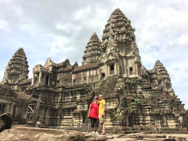 couple standing in front of temples