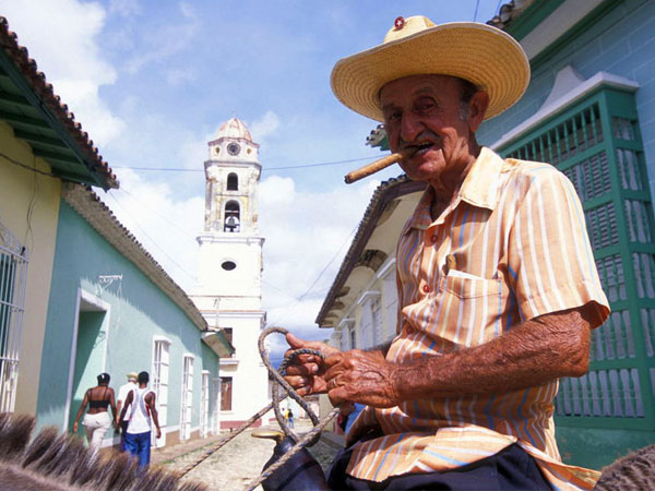 Cuba local man smoking cigar on a horse