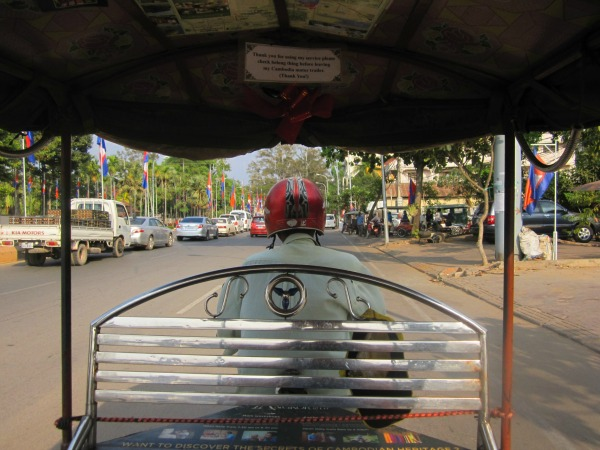 tuk tuk driving through siem reap