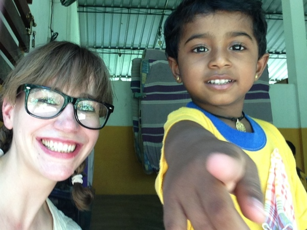 Jennifer with local child in sri lanka