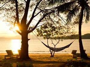 A sunset overlooking the beach on Gaya Island, Borneo
