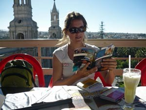 Reading on a balcony in Arequipa, Peru