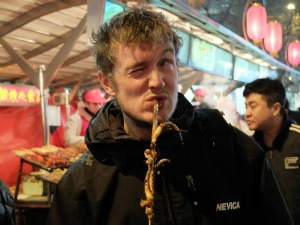 man eating octopus in Asia
