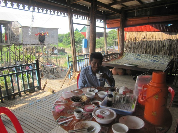 cambodia homestay host drinking tea