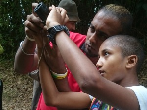 guide and boy looking at camera in Malaysia