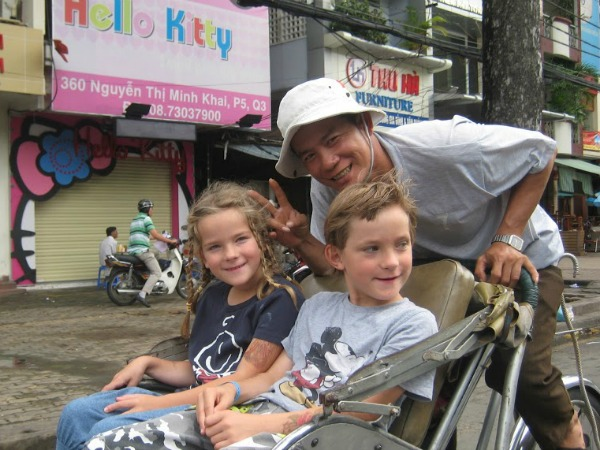 kids on a trishaw in vietnam